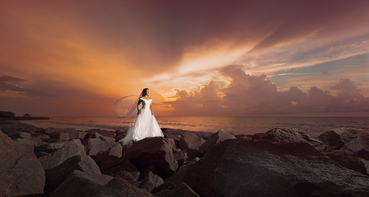 Wedding bride dramatic portrait at beach sunrise | Wedding photographer Raleigh NC