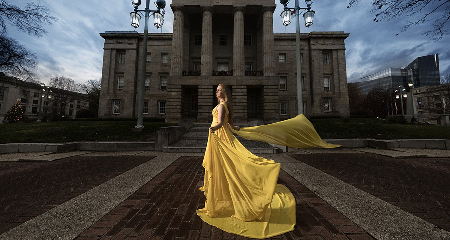 High school senior girl wearing flowing yellow dress  | Wedding photographer Raleigh NC