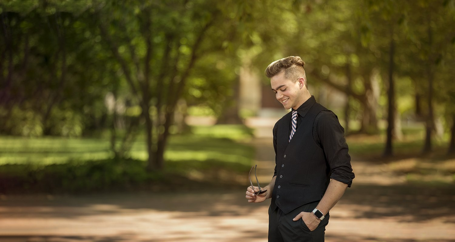 High school senior male smiling  | Wedding photographer Raleigh NC