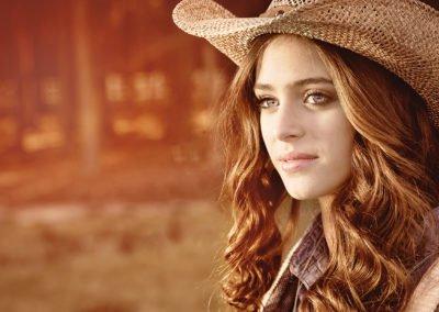 High school senior girl wearing cowboy hat  | Wedding photographer Raleigh NC
