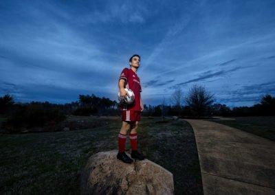 Soccer player against blue sky | Wedding photographer raleigh NC