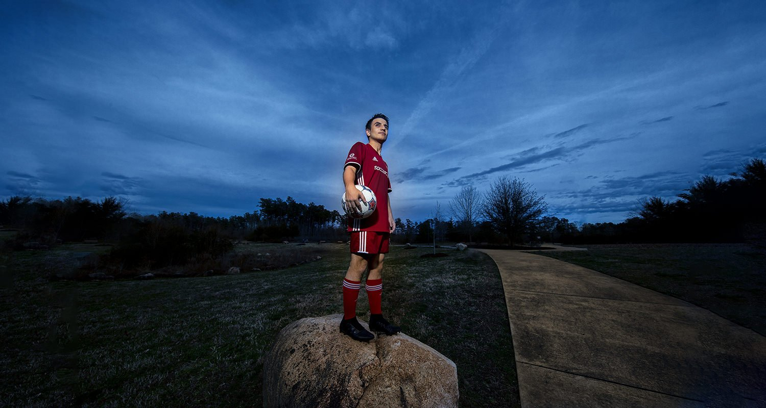 Soccer player against blue sky | Wedding photographer raleigh NC