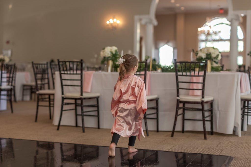Little flower girl on robe before wedding portrait | Wedding photographer Raleigh NC | The Garden on Millbrook wedding