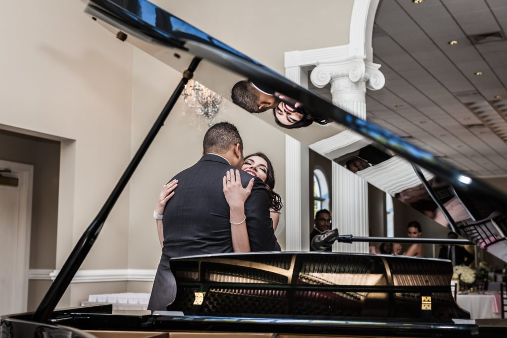 Bride and groom first look by grand piano | Wedding photographer Raleigh NC | The Garden on Millbrook wedding