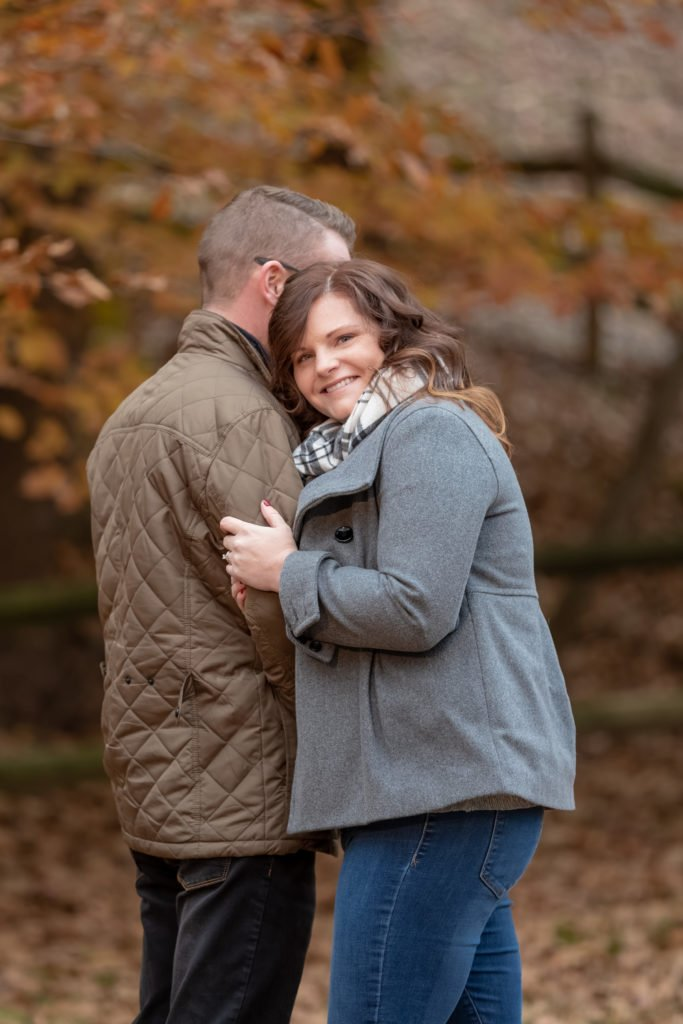 Engagement couple portrait she looks at camera | Wedding photographer Raleigh NC