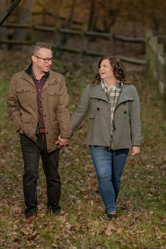 Engagement couple portrait walking and talking | Wedding photographer Raleigh NC