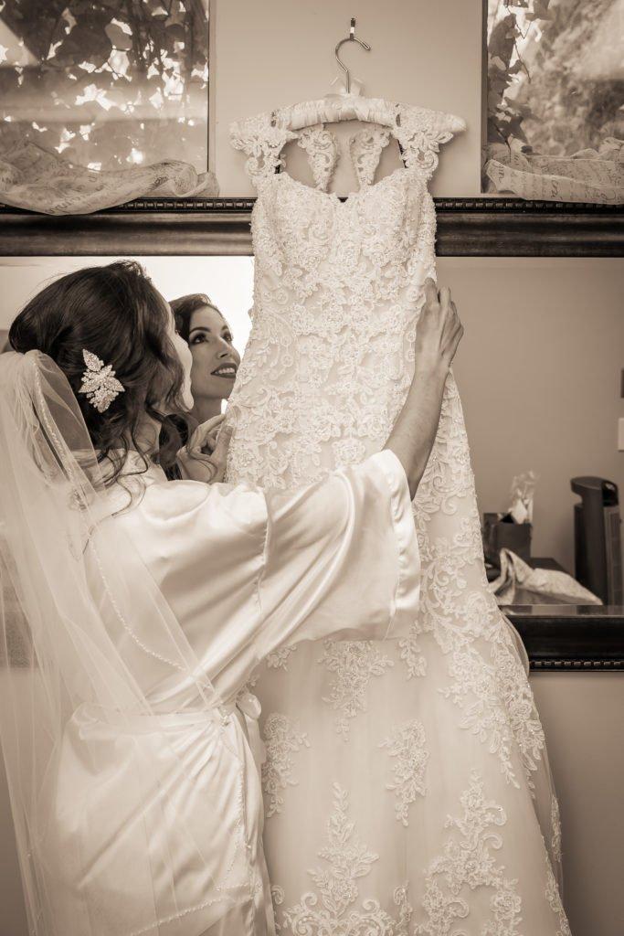 Bride hanging wedding dress | Wedding photographer Raleigh NC | The Garden on Millbrook wedding