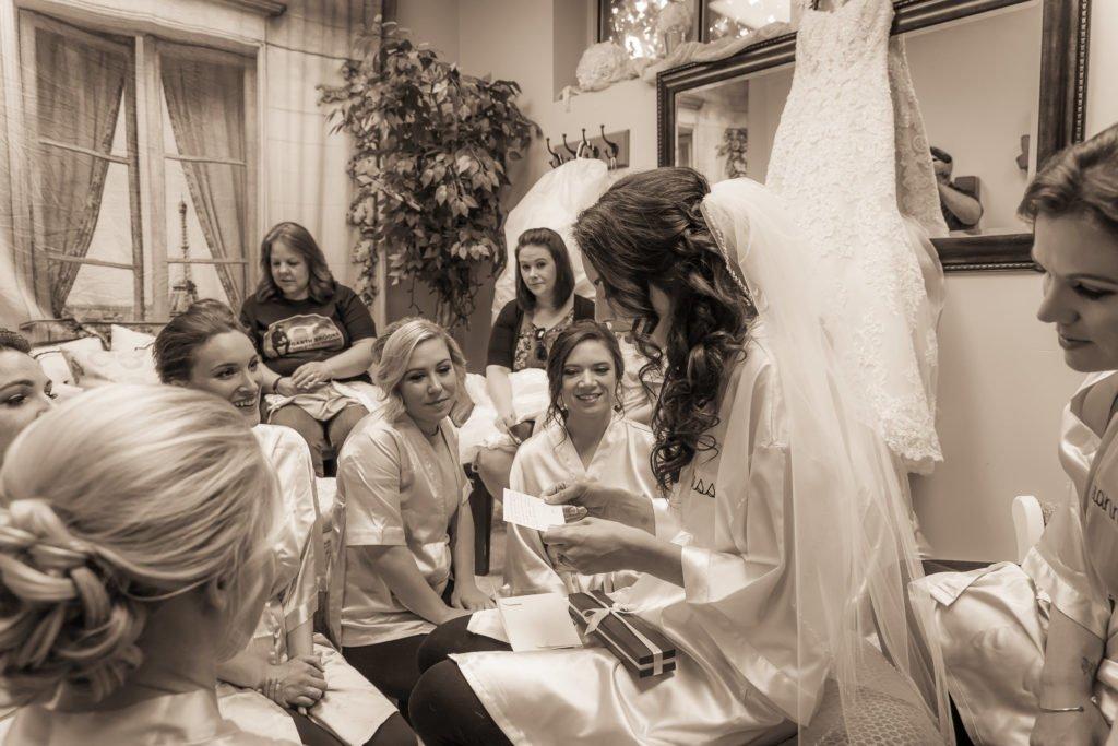 Bride reading groom's message portrait | Wedding photographer Raleigh NC | The Garden on Millbrook wedding