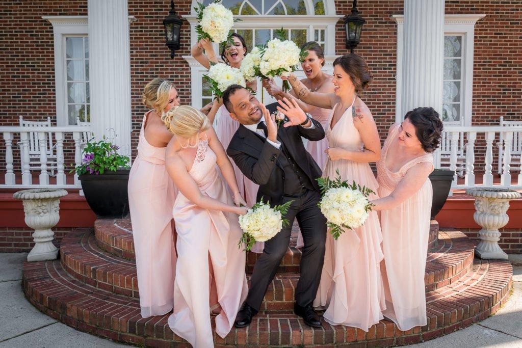 Groom and bridesmaids fun image | Wedding photographer Raleigh NC | The Garden on Millbrook wedding