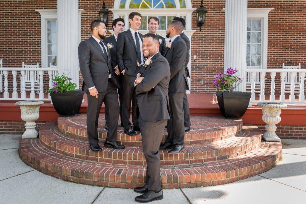 Groom portrait with groomsmen | Wedding photographer Raleigh NC | The Garden on Millbrook wedding