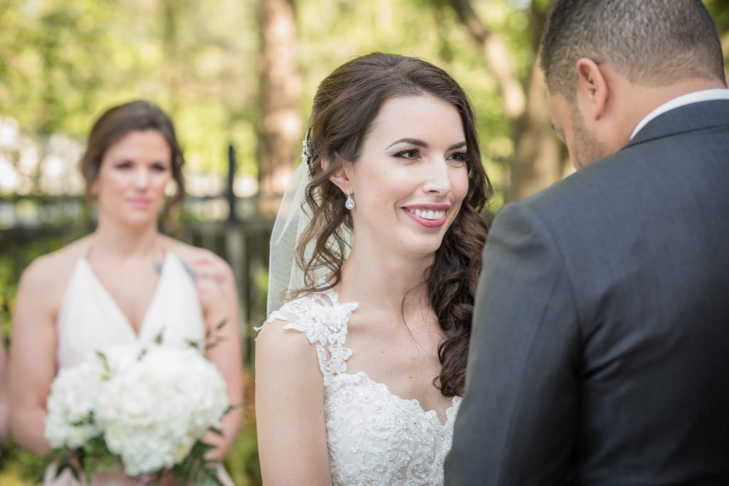 Bride smiling during wedding ceremony | Wedding photographer Raleigh NC | The Garden on Millbrook wedding