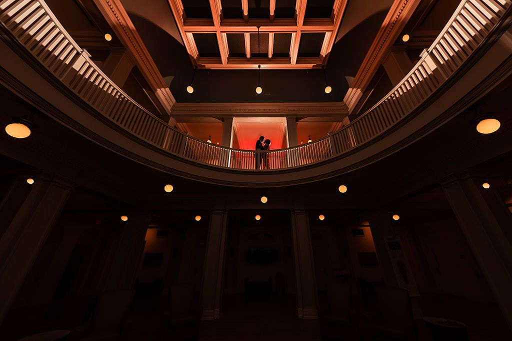 Engagement portrait. Dramatic silhouette shot of couple | Wedding photographer Raleigh NC