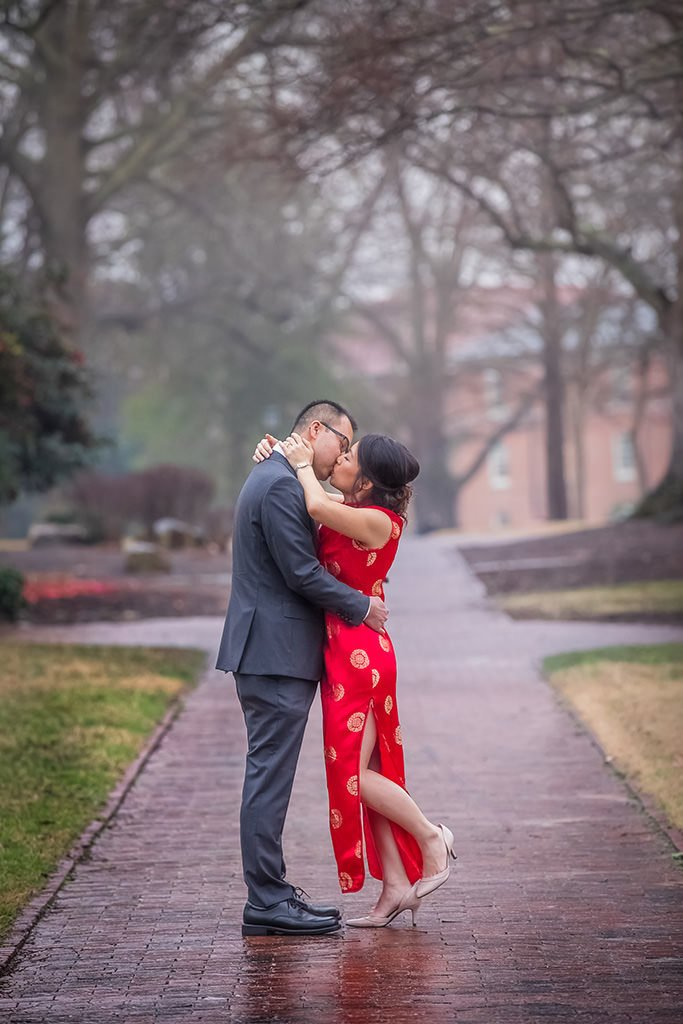 Engagement portrait. Couple kissing outside | Wedding photographer Raleigh NC