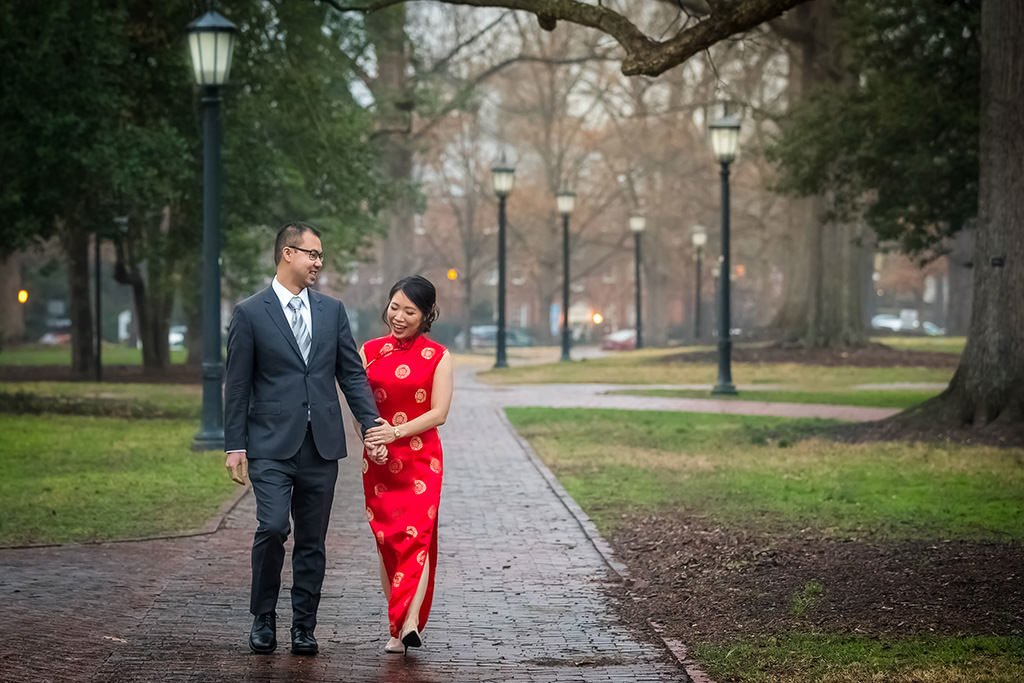 Engagement portrait. Couple walking outside | Wedding photographer Raleigh NC