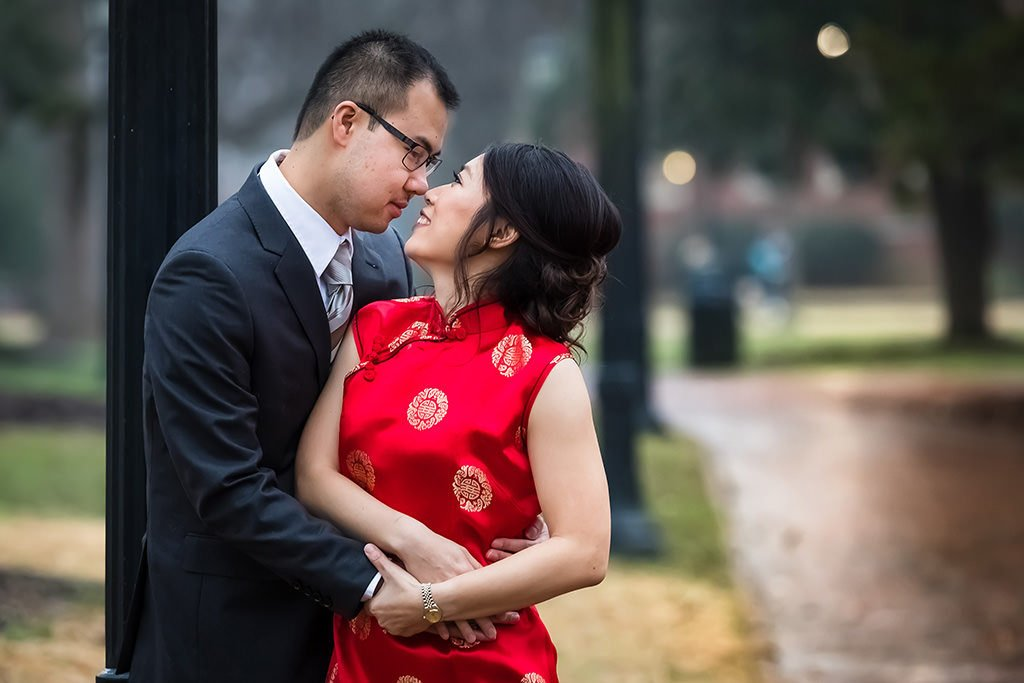 Engagement portrait. Couple looking at each other | Wedding photographer Raleigh NC