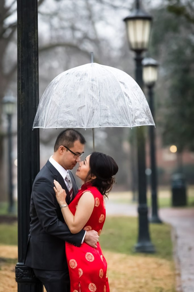 Engagement photos couple kissing under rain | wedding photographer Raleigh NC