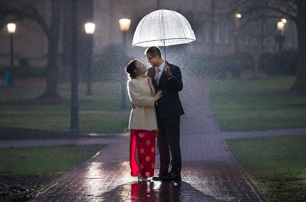 Engagement photos couple kissing under rain | wedding photographer Raleigh NC