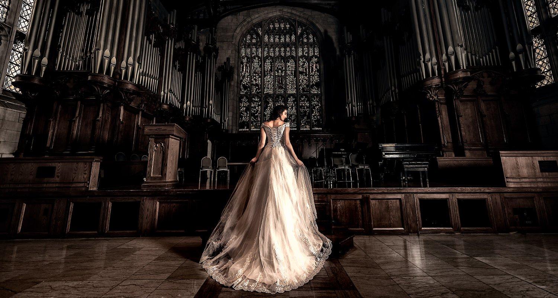 Bride in church with big wedding dress   Raleigh wedding photographer