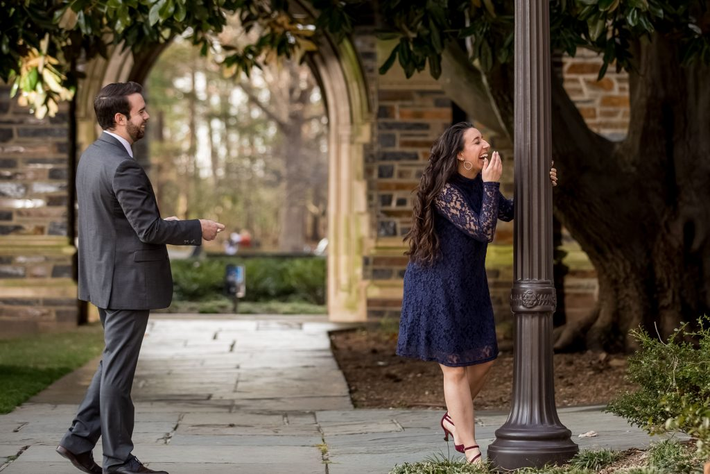 couple-having-fun-at-duke-chapel-engagement-photos