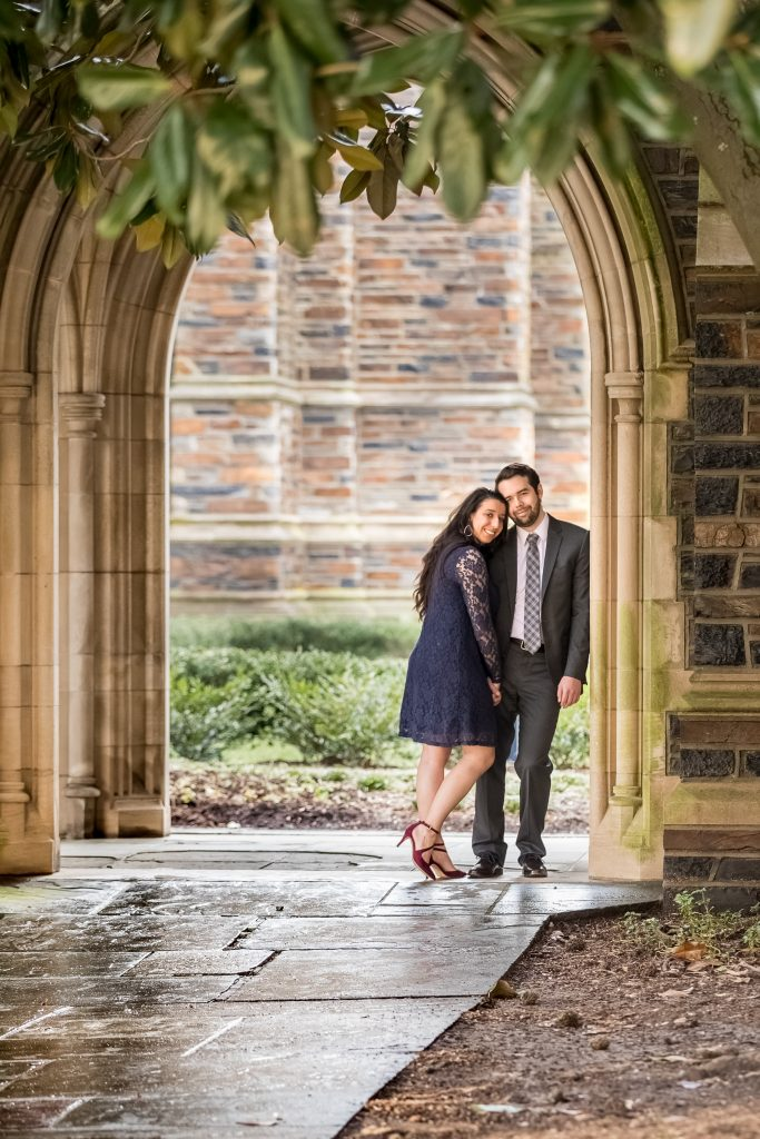 couple-standing-leaning-into-each-other-duke-chapel