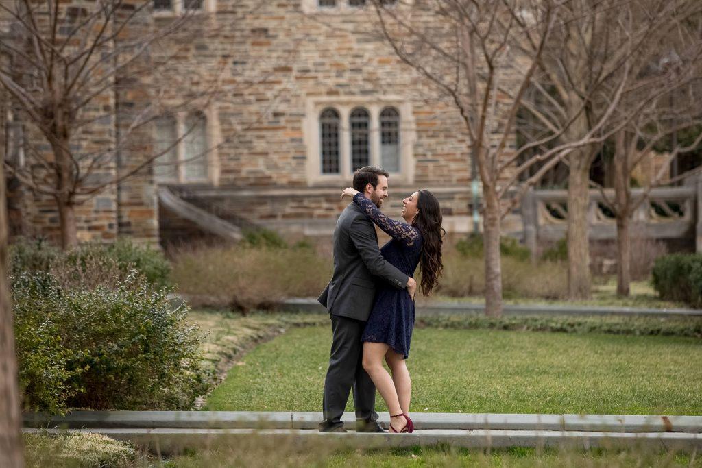 happy-couple-during-engagement-photos-duke-chapel