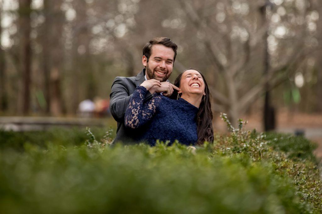 playful-couple-at-engagement-session-duke-chapel