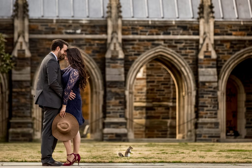 romantic-couple-enjoying-their-time-together-at-Duke-Chapel-in-Durham-NC