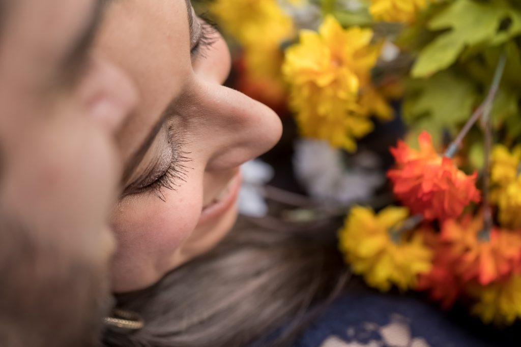 romatic-couple-with-flowers-engagement-photo-duke-chapel