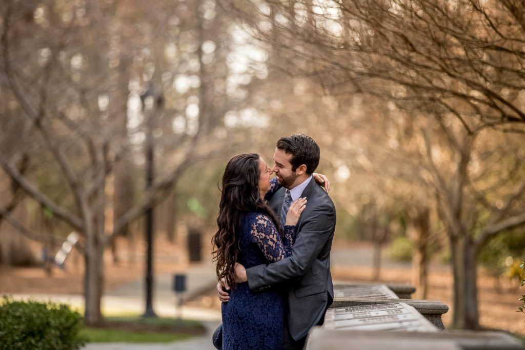 smiling-couple-looking-at-each-other-engagement-duke-chapel