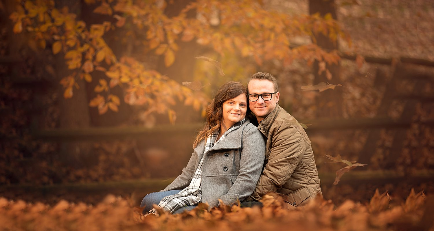 Engagement couple portrait sitting on leaves | Raleigh wedding photographer