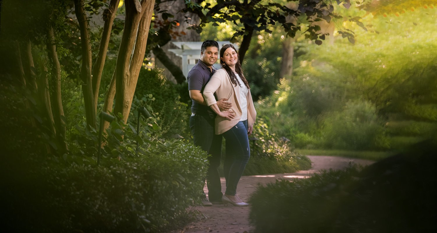 Engagement couple portrait standing on path at Fearrington Village | Raleigh wedding photographer