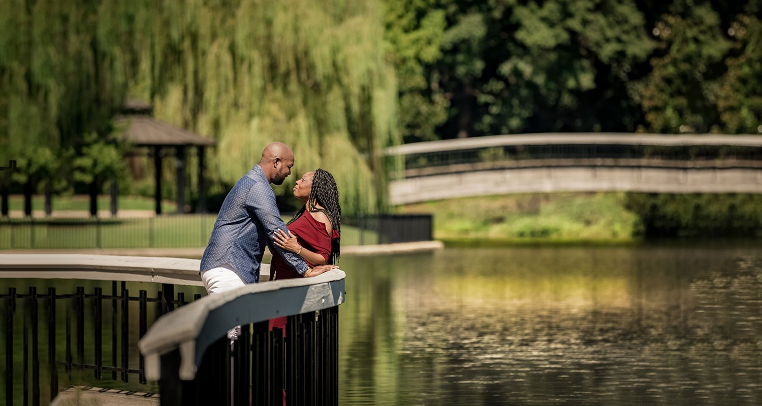 Engagement couple portrait looking at each other | Raleigh wedding photographer