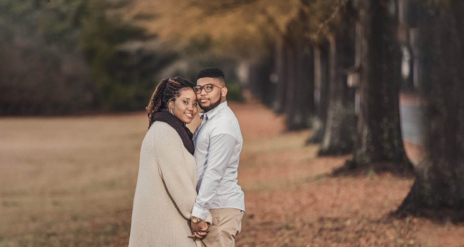 Engagement couple portrait looking at camera| Raleigh wedding photographer