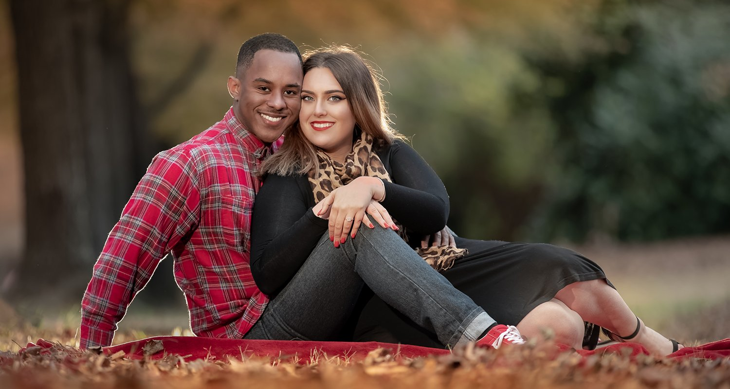 Engagement couples portrait looking at camera | Raleigh wedding photographer