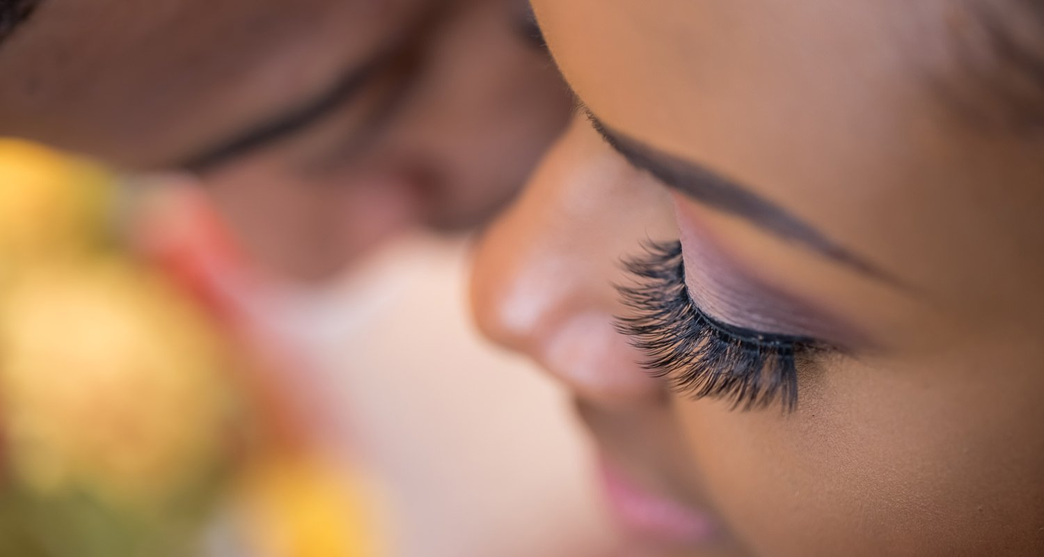 Close up of bride eye lashes with groom on the background - JC Raulston Arboretum engagement | Raleigh wedding photographer