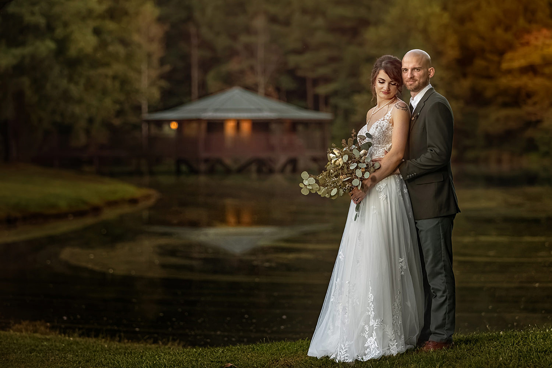 The Barn at Vahalla Wedding - Couple Embracing by the pond