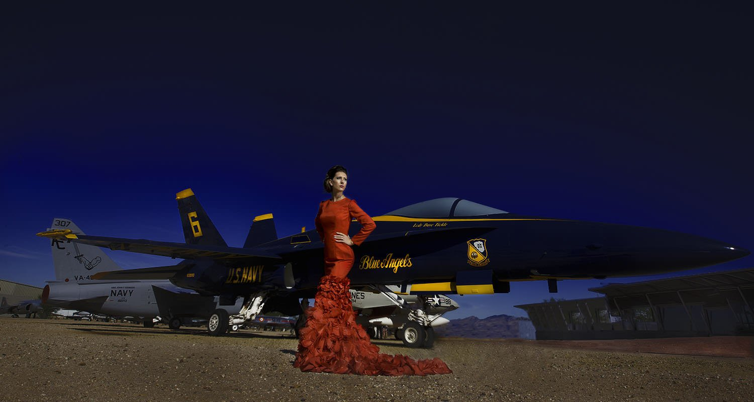Girl on red dress in front of airplane | Raleigh wedding photographer