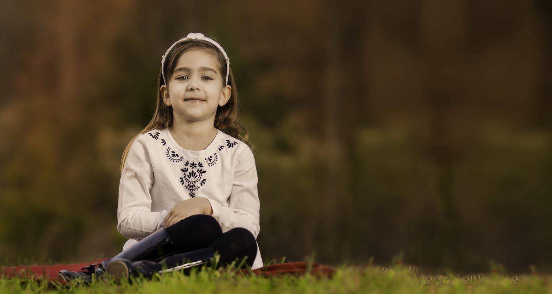 Little girl sitting on grass portrait | Raleigh wedding photographer