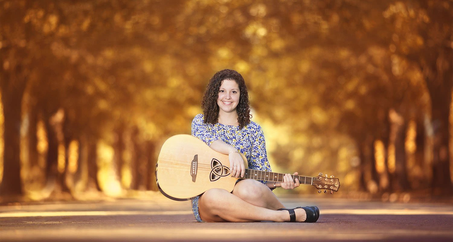 Girl sitting on the ground with guitar | Raleigh wedding photographer