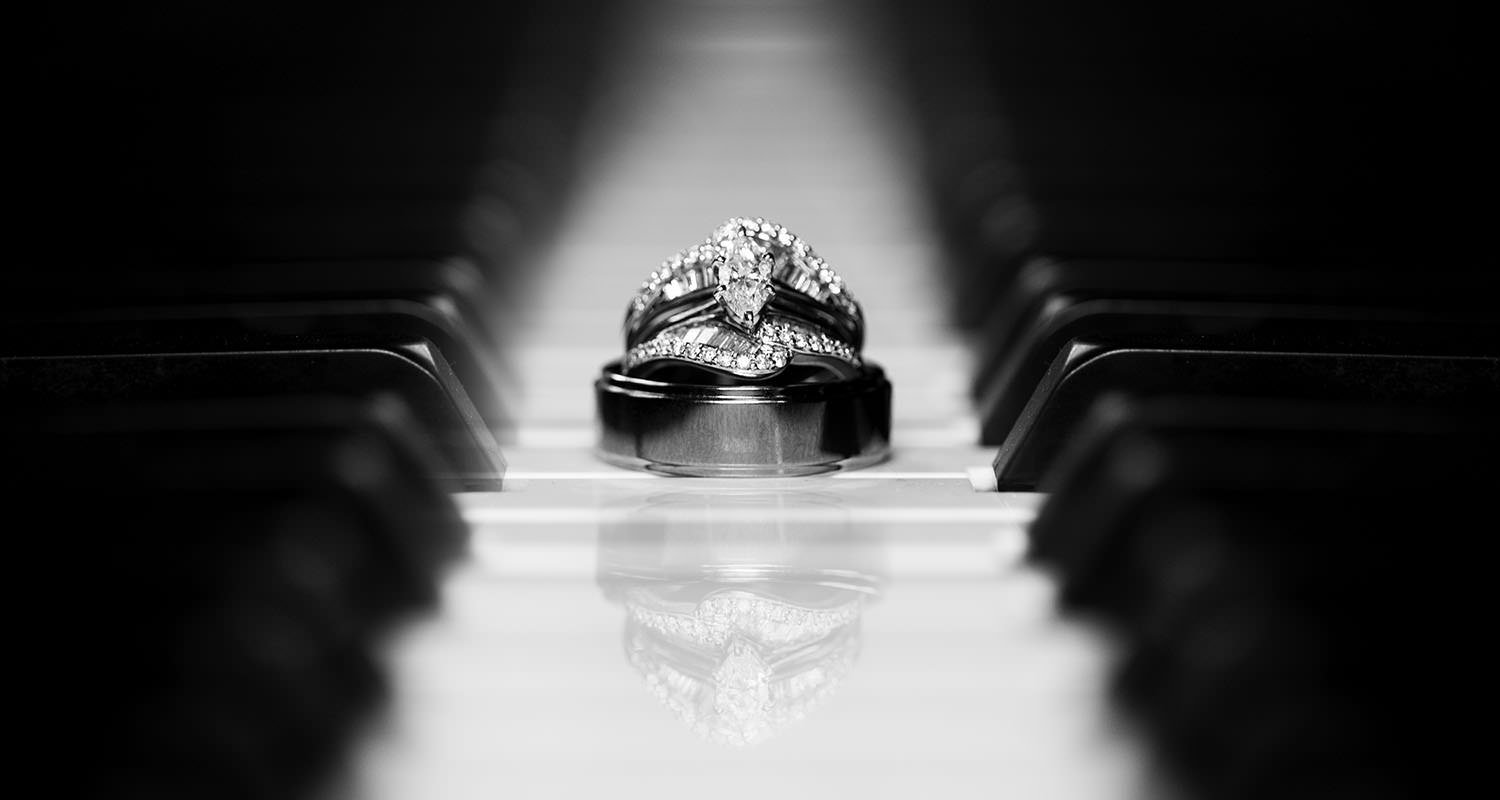 Wedding rings on piano keys | Raleigh wedding photographer
