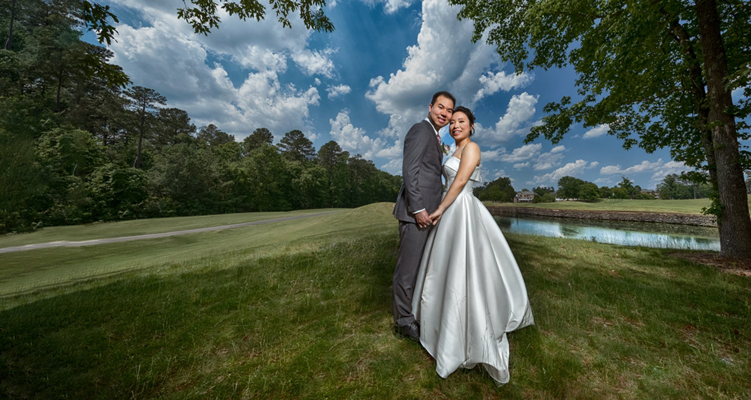 Wedding couple holding hands under tree - Brier Creek wedding  | Raleigh wedding photographer