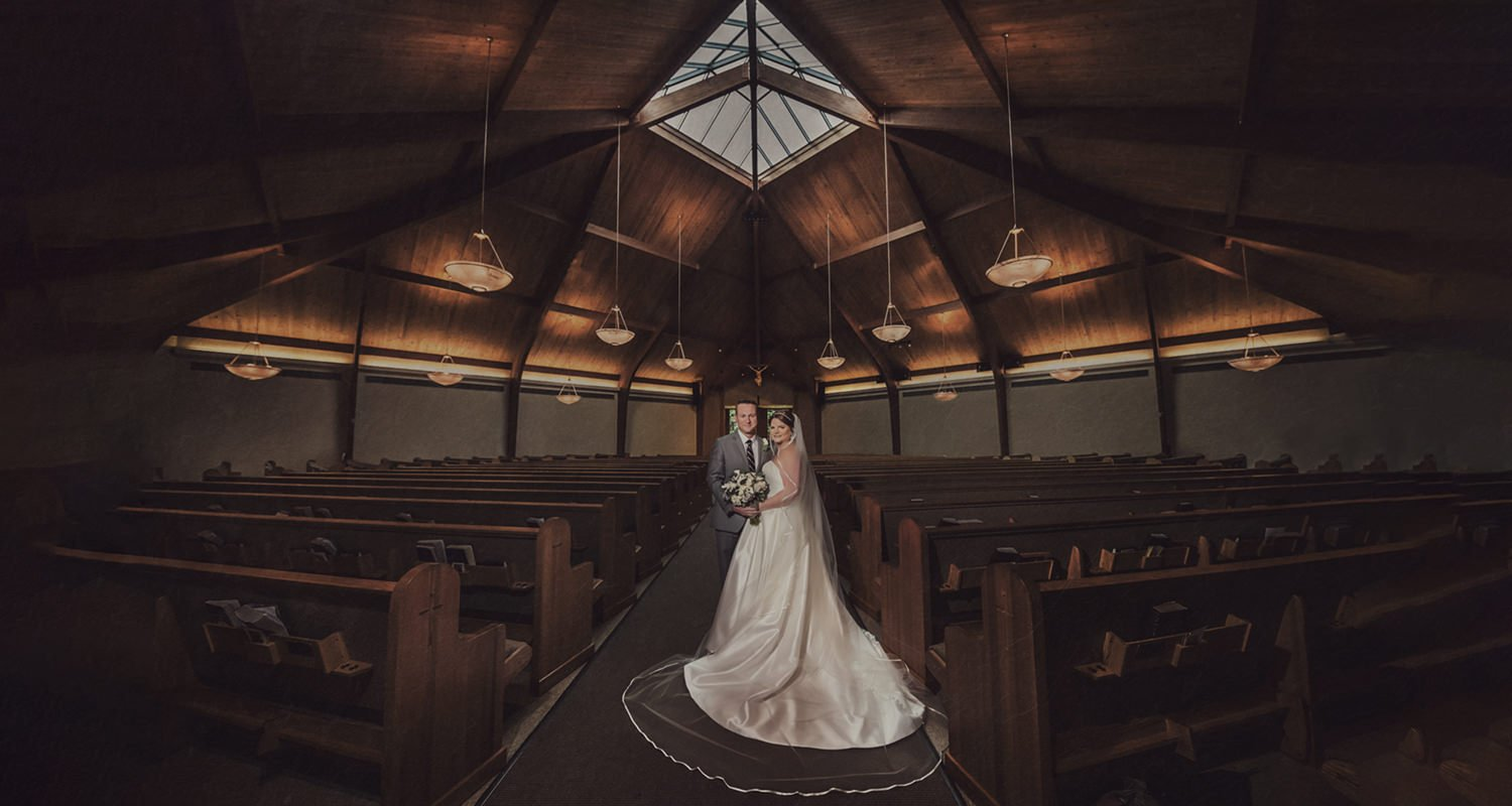 Wedding couple at church - Bella Collina wedding | Raleigh wedding photographer