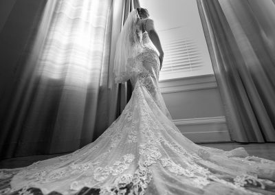 Bride on wedding dress looking out the window | Raleigh wedding photographer