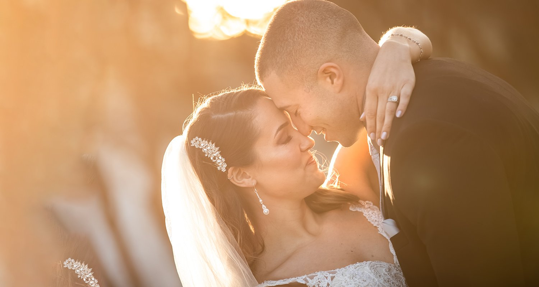 Wedding couple hugging at sunset | Raleigh wedding photographer